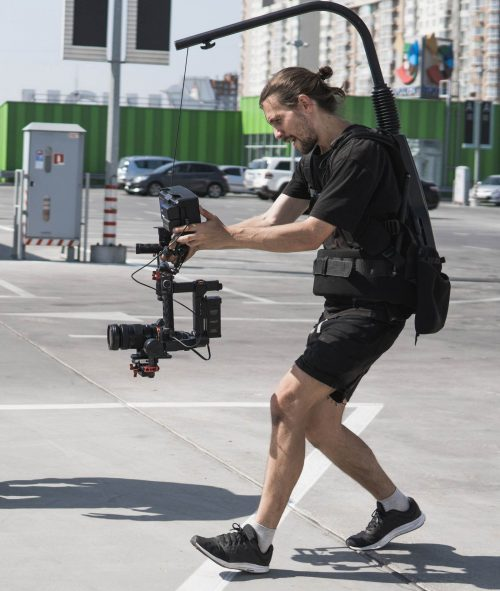 Image of our staff at Elite Video of Boise shoowing some footage out in a parking lot.